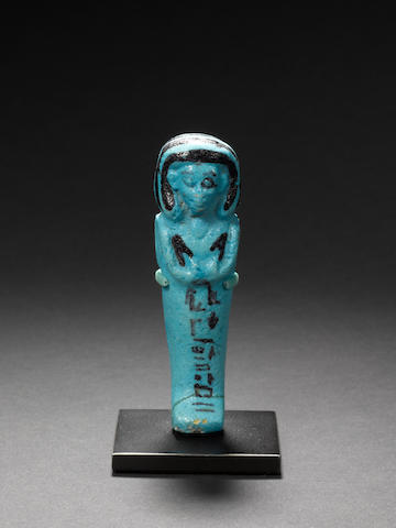 An Egyptian bright blue glazed composition shabti