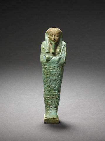 An Egyptian green glazed composition shabti with hieroglyphs