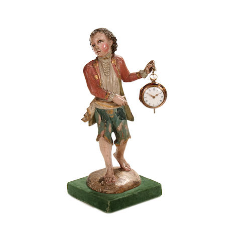 A late 18th century gilt metal and tortoiseshell pair cased pocket watch now hanging from an 18th century Neapolitan carved wood figureby Evans & Son, Shrewsbury
