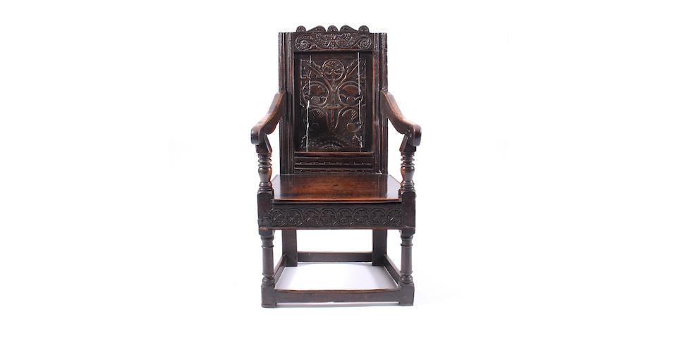 A James I oak panel back armchair Of rare design