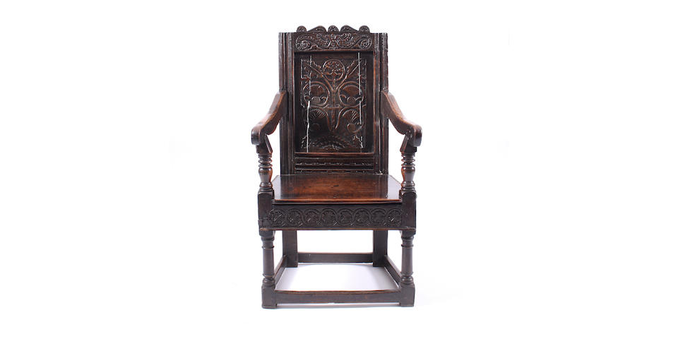A James I oak panel back armchair Of rare design