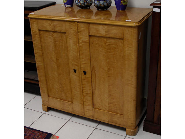 A Swedish Biedermeier satinbirch cupboard