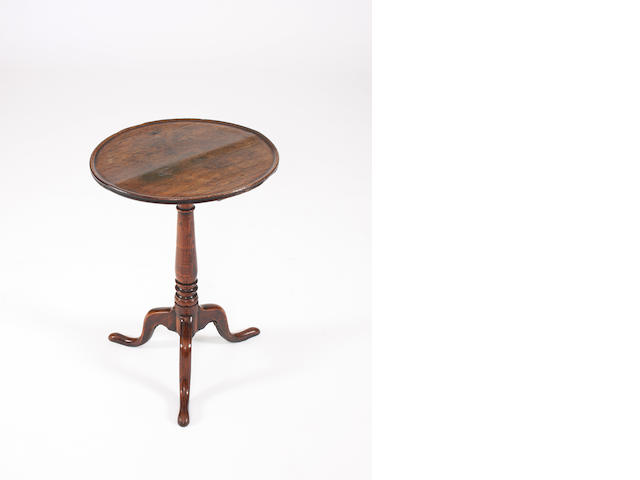 A George III oak dished top wine table
