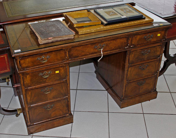 A walnut twin pedestal desk,