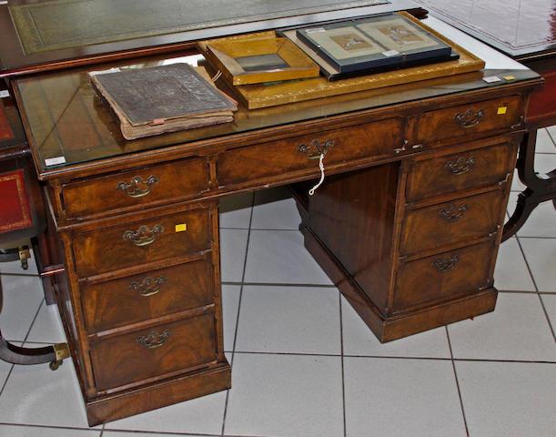 A walnut twin pedestal desk,