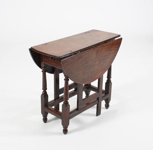 An oak gateleg occasional table, circa 1700