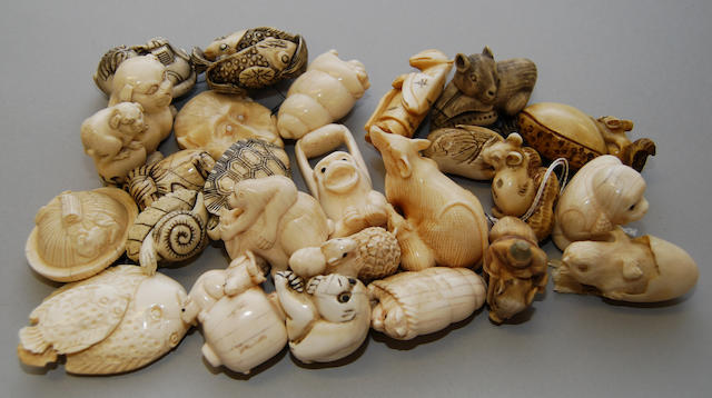 A group of various carved ivory animal netsuke