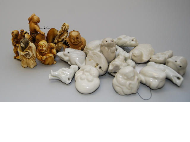 A group of eight figural netsuke