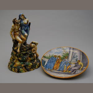 A late 19th century maiolica charger and a maiolica Urbino-style figure group