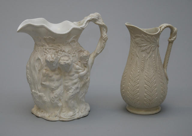 Two relief-moulded white stoneware jugs
