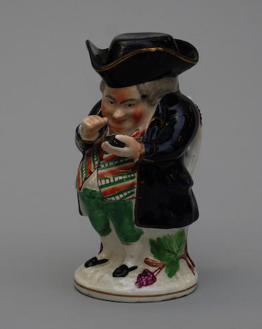 A Staffordshire Scottish-type Toby jug