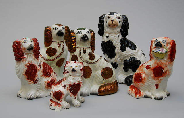 A group of six Staffordshire spaniels