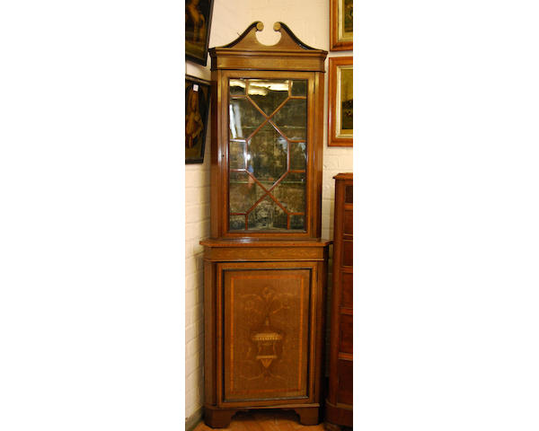 An Edwardian mahogany, inlaid and painted standing corner cupboard