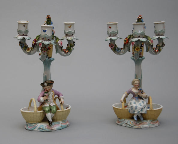 A pair of German porcelain candelabra