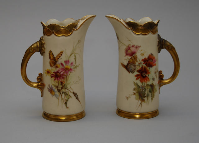 A pair of Royal Worcester blush ivory jugs