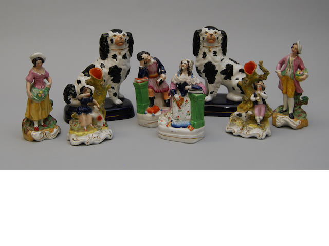 A collection of eight Staffordshire figures