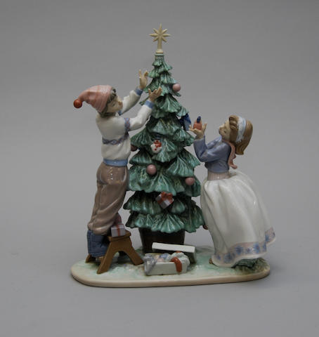 "A Lladro figure group ""Trimming the Tree"""