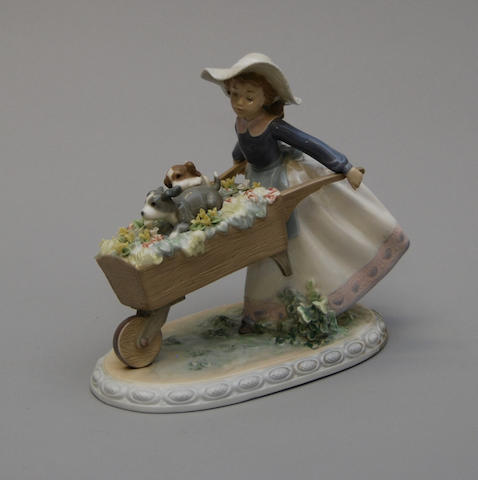 A Lladro figure of a girl with a wheelbarrow