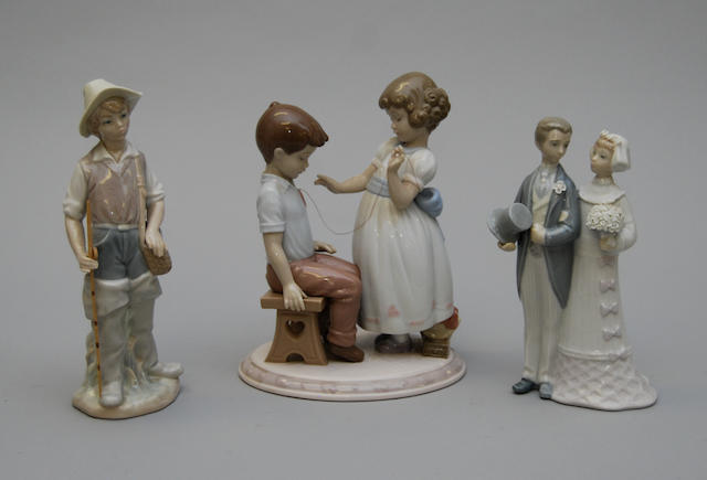 Three Lladro figure groups