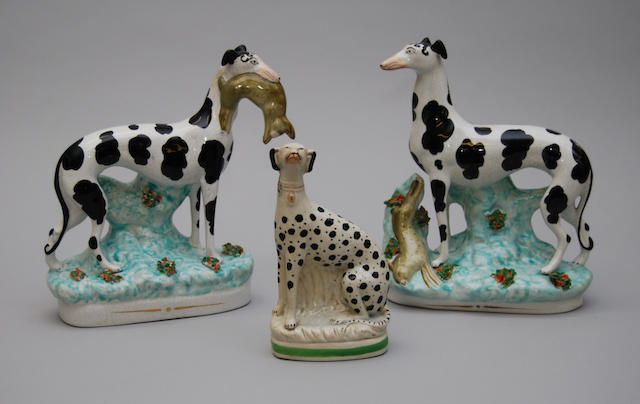 A pair of Staffordshire pottery greyhounds