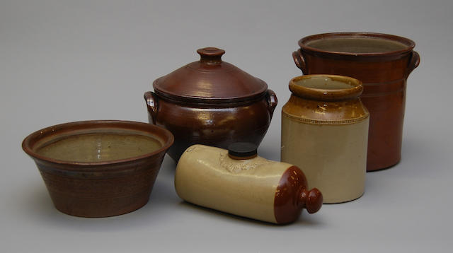 A small collection of earthenware and stoneware pots