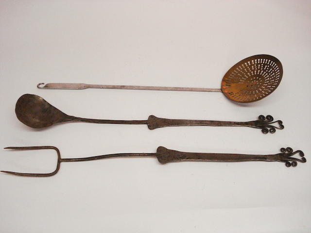 Three steel cooking implements