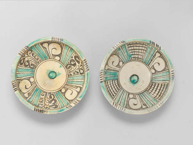 A pair of Timurid underglaze-painted pottery Bowls Persia or Central Asia, 15th Century(2)