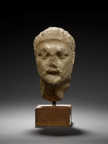 A Hellenistic marble portrait head of bearded man