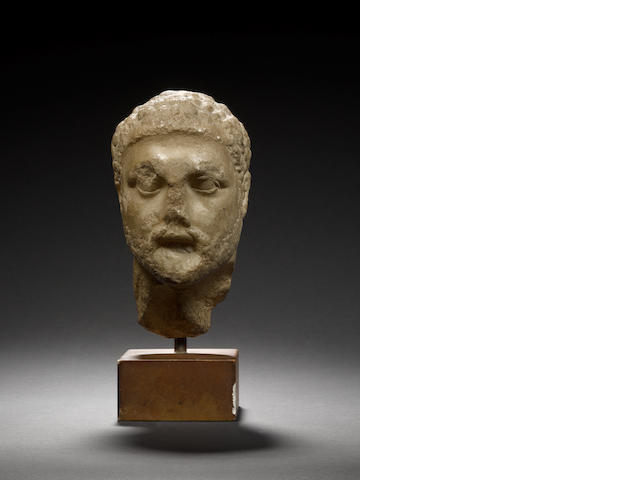 A marble head of bearded man