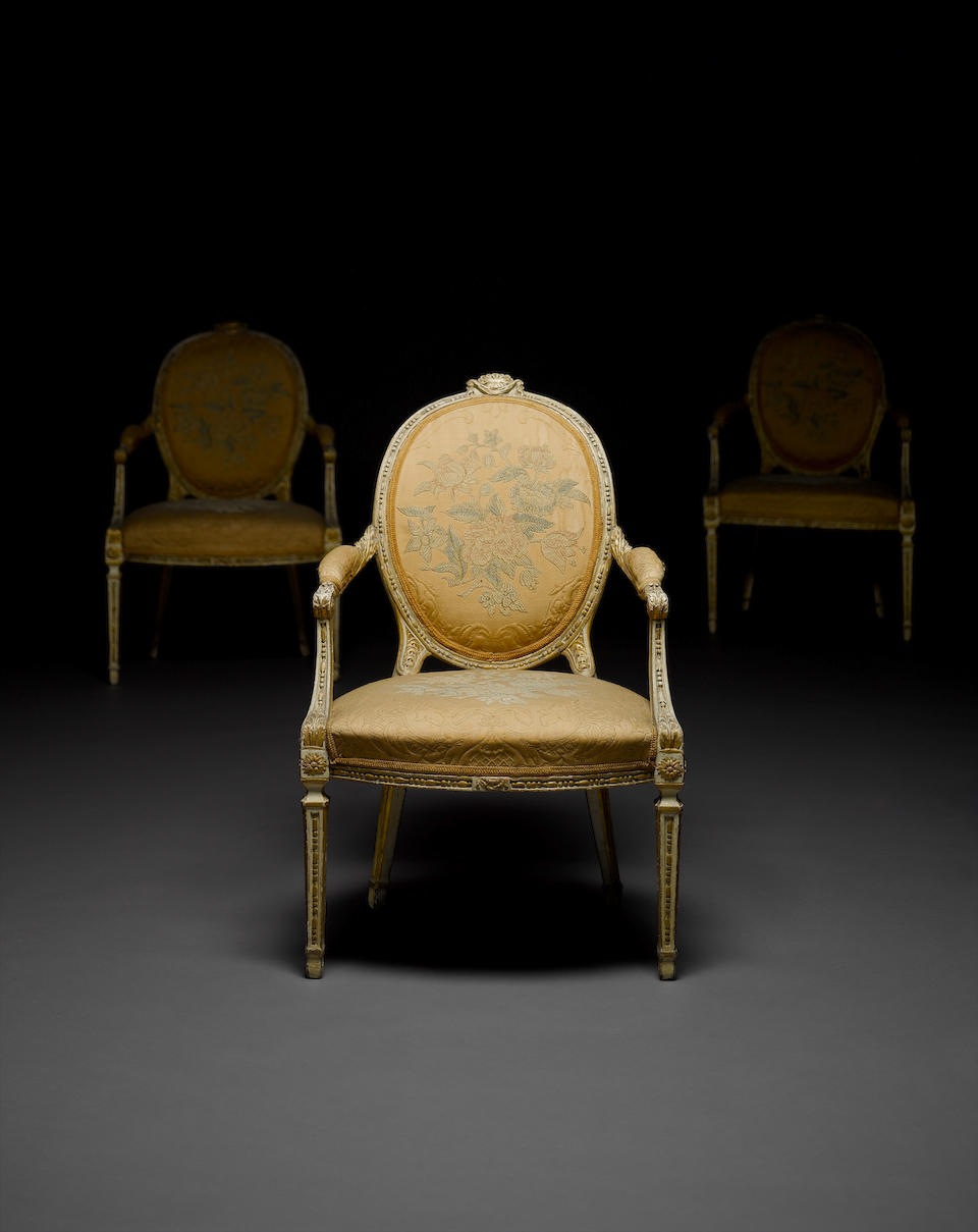 An important and rare George III white painted and parcel gilt salon suite comprising twelve open armchairs and a pair of sofasattributed to William and John Linnell
