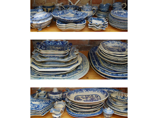 A large collection of blue and white Staffordshire wares