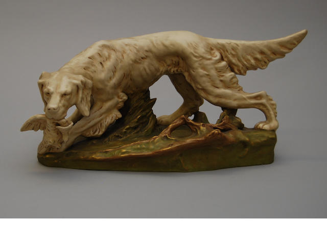 A Royal Dux figure of a dog