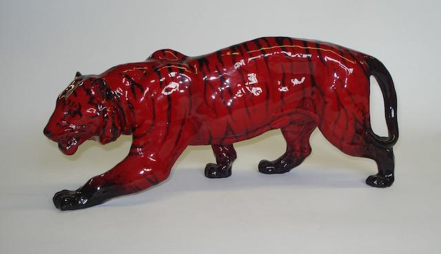 Flambe Wares A Royal Doulton Flambe figure of a stalking tiger