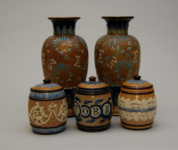 A pair of Royal Doulton vases with three tobacco jars