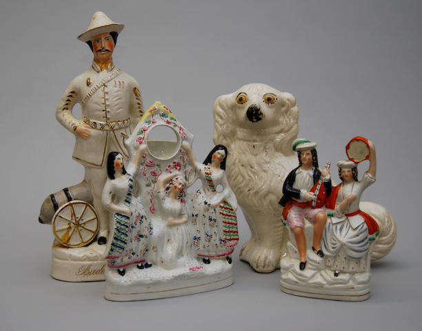 A mixed collection of Staffordshire figures