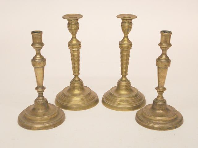 Two pairs of French brass candlesticksBoth late 18th/early 19th Century