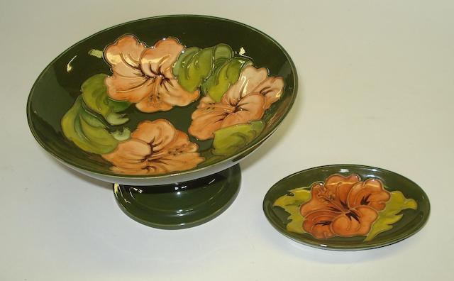 A Moorcroft Coral Hibiscus pattern pedestal dish