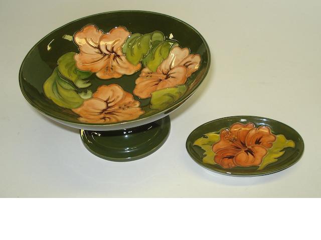 A Moorcroft Coral Hibiscus pattern pedestal dish