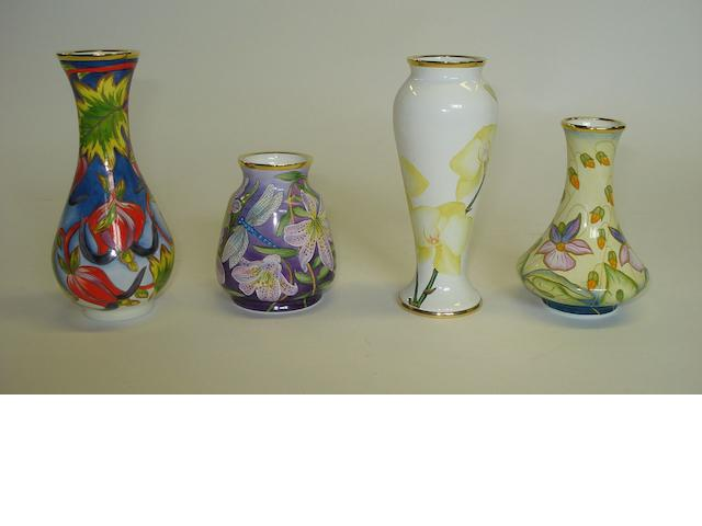 A collection of four Moorcroft enamel vases