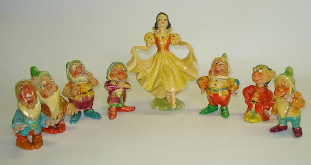 A complete set of Wade 'Snow White and the Seven Dwarfs' figures Circa 1930