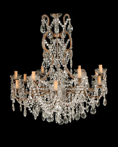 A Marie Therese style gilt metal and glass twelve light chandelier