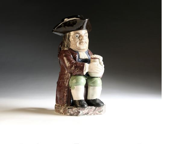 A Staffordshire Toby Jug and crown, circa 1820