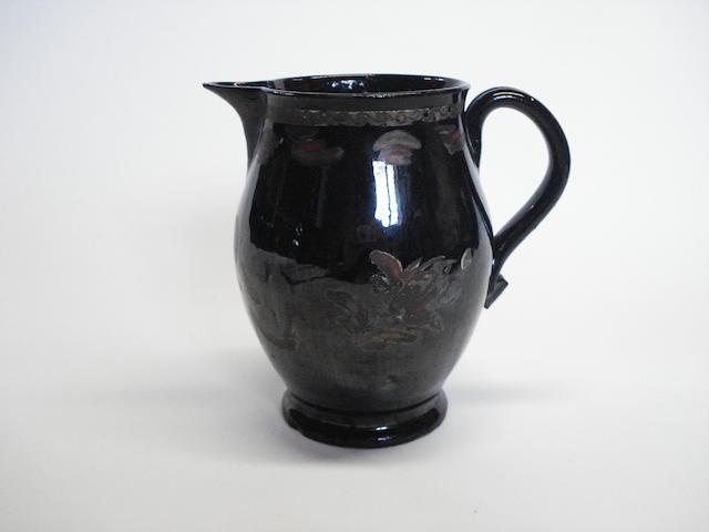 A Jackfield jug, circa 1770