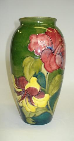 A Moorcroft Coral Hibiscus pattern vase