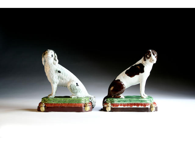 A pair of Staffordshire figures of seated dogs