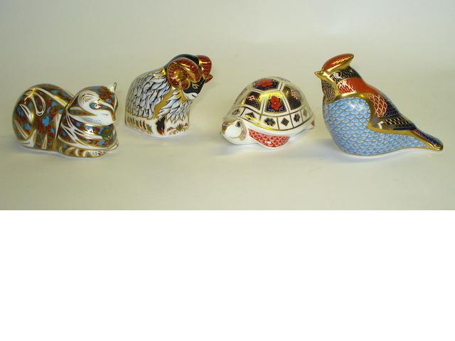 A group of four Royal Crown Derby paperweights