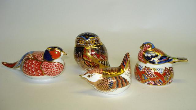 A collection of four Royal Crown Derby paperweights