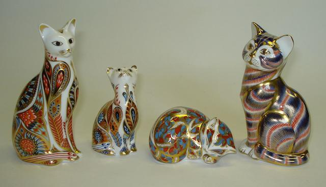 A collection of Royal Crown Derby cat paperweights