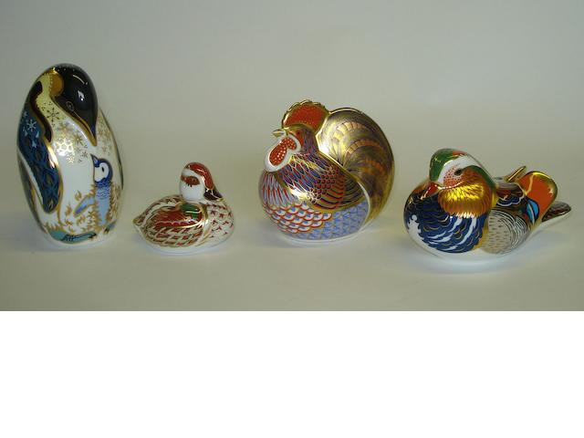 A group of four Royal Crown Derby bird paperweights