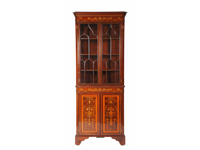 An Edwardian inlaid mahogany corner cabinet.